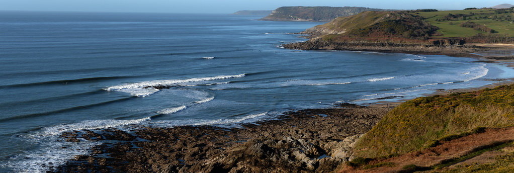 overview of surf fringed coastline gower