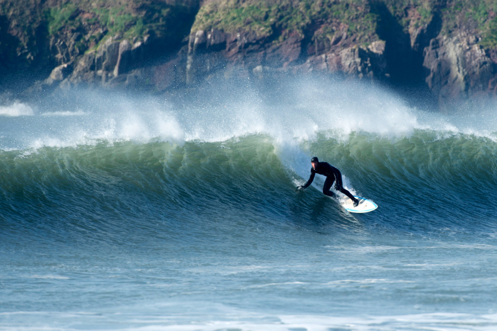 surfer on offshore waves