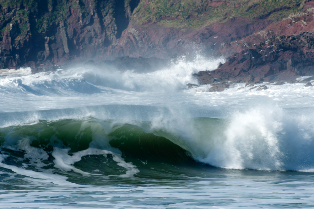 Tubing wave red sandstone cliffs
