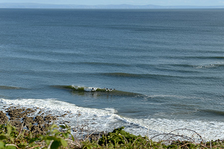 overview blue reef waves and surfers